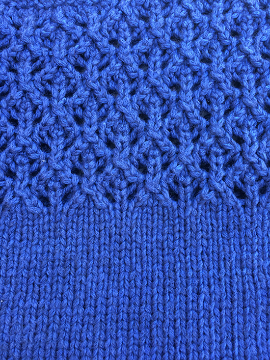 Close up of lace st and stocking stitch in Rowan Softyak DK